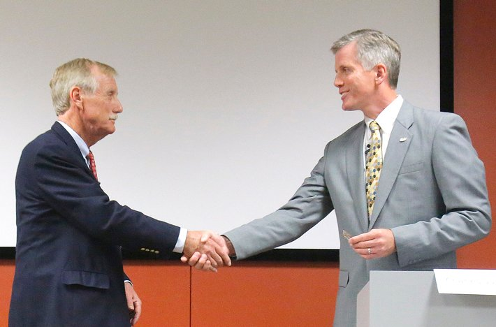 U.S. Senate candidates Angus King, left, and Charlie Summers shake hands at the end of their debate at Texas Instruments in South Portland on Wednesday.