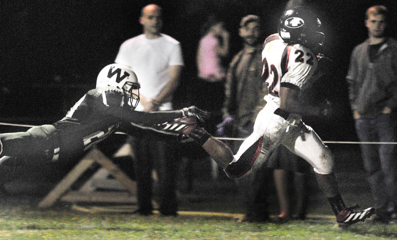 Staff photo by Joe Phelan Lisbon running back Quincy Thompson, left, out runs Winthrop corner back Damion Hanson into the corner of the end zone to score during a game on Friday night at Maxwell Field in Winthrop.