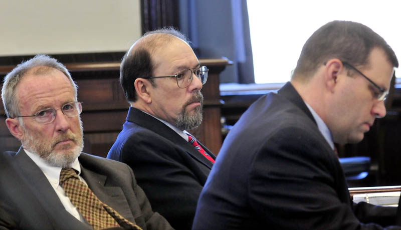 Staff photo by David Leaming DEFENSE: Murder defendant Jay Mercier sits between defense attorneys John Alsop, left, and John Martin during Mercier's trial in the death of Rita St. Peter being held at Somerset County Superior Court in Skowhegan this week.