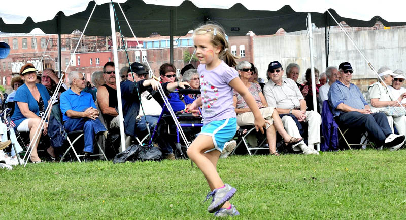 """Alice Willette dances as folks listen to the Blistered Fingers blue grass band perform during the Franco-American Festival in Waterville on Sunday. The festival, which included food and concessions, was held at Head of Falls. """"I hope some kids come out and dance with me,"""" Willette said."""