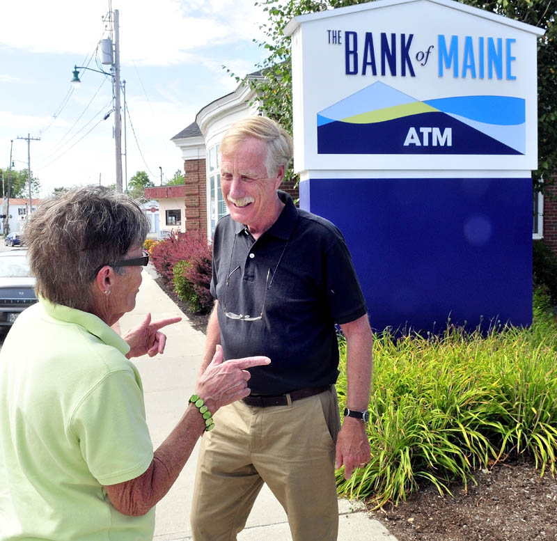 U.S. Senate candidate Angus King speaks with Penny Rafuse of Waterville during a campaign stop in Oakland. King left the Board of Directors for The Bank of Maine to allow him to campaign for U.S. Senate.