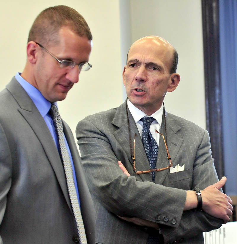 INVESTIGATION: Assistant Attorney General Andrew Benson, right, confers with Maine State Police Detective Ryan Jacques prior to opening statements in the murder trial of Jay Mercier in Somerset County Superior Court in Skowhegan.