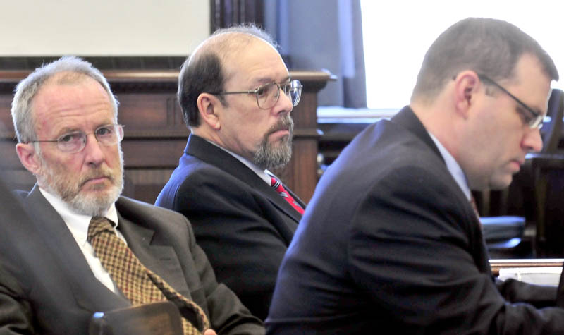 Staff photo by David Leaming COLD CASE: Flanked by his attorneys John Alsop, left, and John Martin, defendant Jay Mercier listens to opening statements in the trial in the death of Rita St. Peters in Somerset Superior Court in Skowhegan on Thursday.