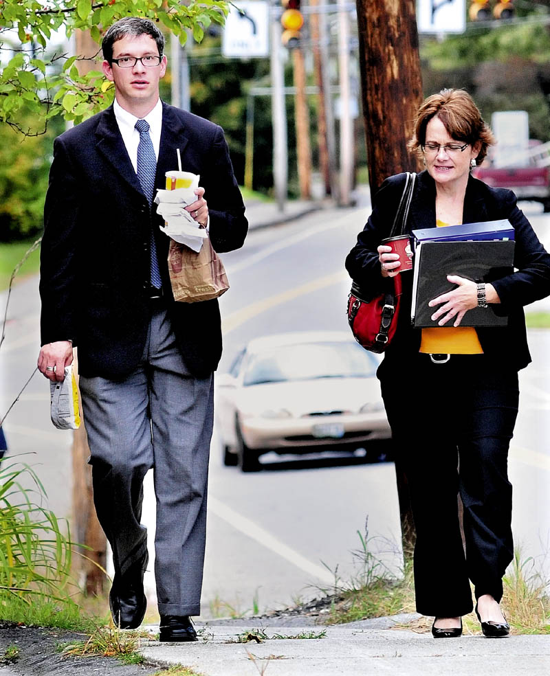 Steven Chardo and Cathy MacMillan, forensic chemists with the Maine State Crime lab, return to the Somerset County Superior Court in Skowhegan where Chardo testified earlier in the Jay Mercier murder trial on Monday.