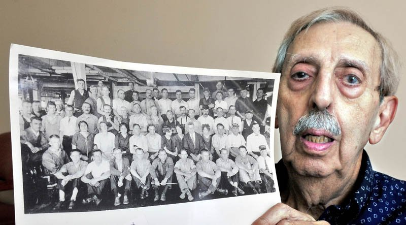 Peter Joseph holds a photograph taken in the early 1930s of Wyandotte Mill employees, including his father, John Joseph Sr.