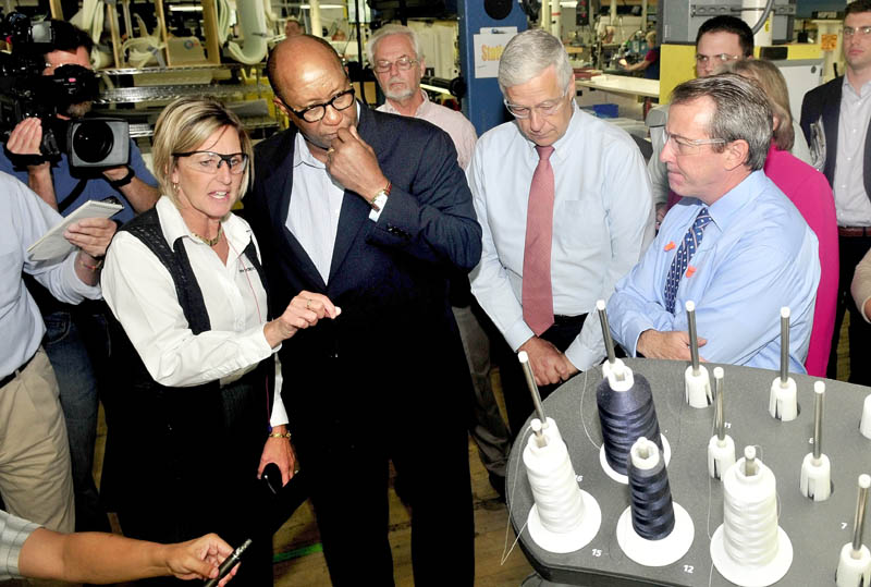 TOUR OF DUTY: New Balance Plant Manager Raye Wentworth explains a shoe- making process to U.S. Trade Representative Ambassador Ron Kirk and U.S. Rep. Mike Michaud at the Norridgewock plant on Thursday. Company President Rob DeMartini is at right.