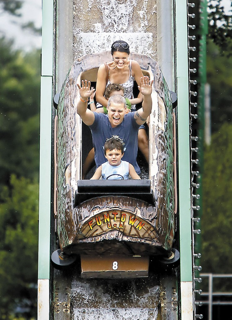 Brian Arel of South Portland rides the Thunder Falls Log Fume with his wife Jill and their children Aiden, 6, front, and Keegan, 2, at Funtown Splashtown USA in Saco on Friday.