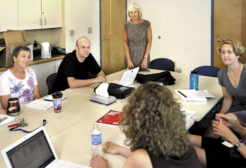 Falmouth Superintendent Barbara Powers, standing, meets with Falmouth High School Social Studies teachers recently to discuss measures concerning this year's curricula as well as the federally mandated No Child Left Behind Act.