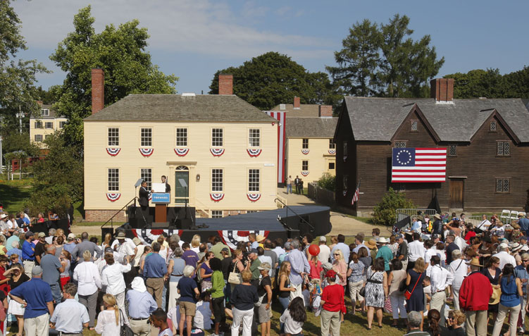 The field at the Strawbery Banke Museum in Portsmouth, N.H., where President Obama will speak later Friday is lined by historic homes.
