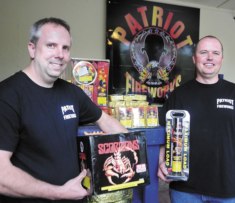 Staff photo by Joe Phelan Another view: Tim Bolduc, left, and Jay Blais recently opened Patriot Fireworks in Monmouth earlier this year. A petition drive to limit fireworks use in Monmouth would not affect sales.