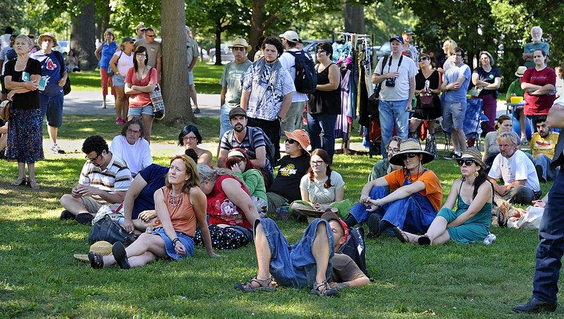 Some of those attending the Atlantic CannaFEST at Deering Oaks in Portland listen to music, speakers and promotions of medical marijuana on Saturday.