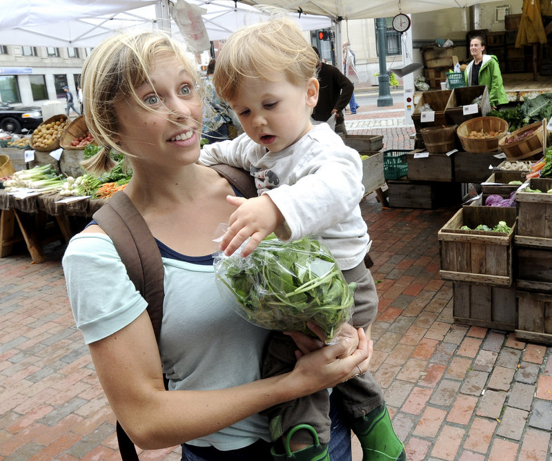 """Anna Korsen of Portland, shopping with her 2-year-old son, Arlo Korsen-Cayer, says, """"I tend to buy organic because of the impact conventional farming has on the environment and the pesticides that are in a lot of conventionally grown food."""""""