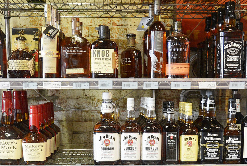 Liquor is on display at Downeast Beverage on Commercial Street in Portland on Thursday, Sept. 6, 2012. The negotiations for the new state liquor contract have been questioned by a prominent state legislator before the bids have even been submitted.