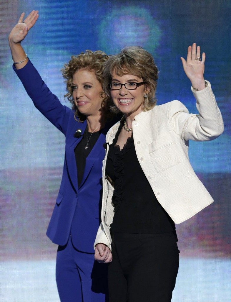 Former Rep. Gabrielle Giffords waves after reciting the Pledge of Allegiance with Democratic National Committee Chairwoman Rep. Debbie Wasserman Schultz in Charlotte, N.C., Thursday.