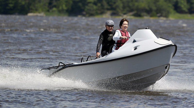"Sen. Susan Collins pilots a rescue craft in July built at the Hodgdon Defense Composites Facility in Bath for the U.S. Air Forces Special Command. She is accompanied Peter Maguire, co-founder of Rapid Response Technology, designer of the craft. Collins has expressed concerns about possible ""meat-ax cuts"" to defense programs."