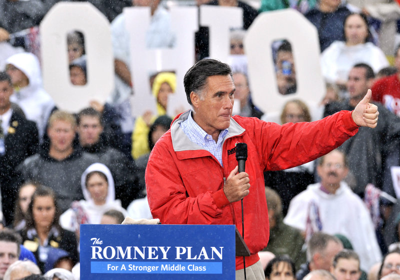 "Republican presidential candidate Mitt Romney campaigns in the rain Friday in Painesville, Ohio. ""There will not be a second term,"" he told the crowd."