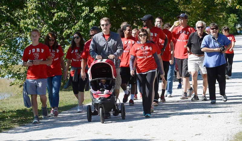 A group known as Gabby's Gang walks for Gabby Maines, 8, of Waterville, who has type 1 diabetes, during the Juvenile Diabetes Research Foundation International's walk to cure diabetes at Payson Park in Portland on Sunday. Chad and Alex Higgins of South Portland lead the way while pushing 8-month-old Molly in a stroller.
