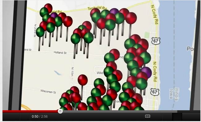 A YouTube demonstration video shows how the Mobile Voter app uses colored pins to distinguish the party affiliations of voters in a neighborhood.