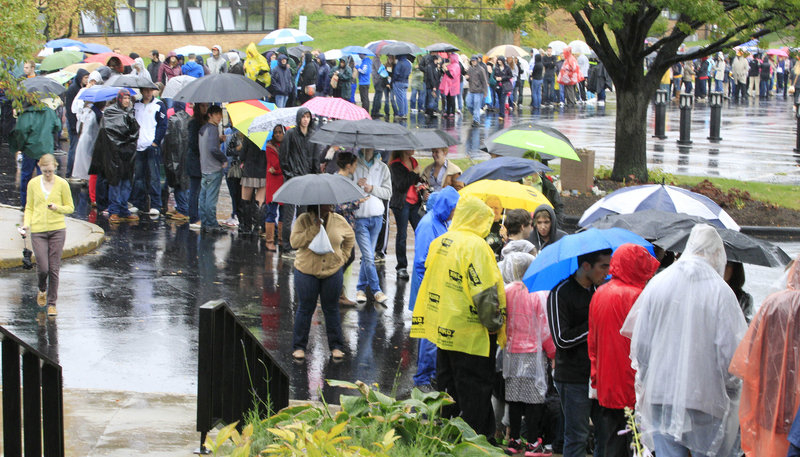 Students line up Wednesday outside the Memorial Athletic and Convocation Center at Kent State University in Kent, Ohio, to hear President Obama speak. College students are among the groups selected by tea party activists in Ohio to target for purging from voter lists.