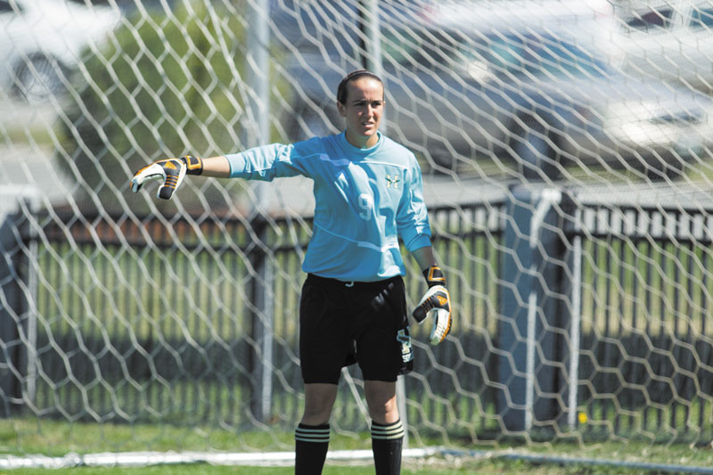 Contributed photo TEAM LEADER: Lawrence High School graduate Jess Poulin is a two-year starter in goal for the Husson women's soccer team. She also plays for the Husson softball team.