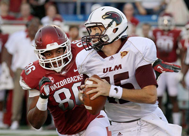Arkansas' 34-31 loss to Louisiana-Monroe in overtime Saturday knocked the Razorbacks out of the AP college football poll. The Razorbacks were ranked eighth. NCAA