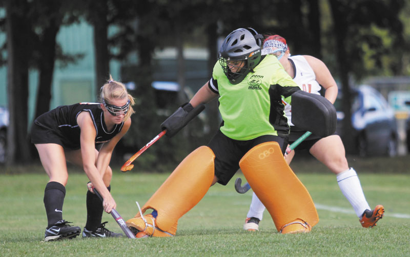 PUTTING A STOP TO IT: Winslow High School goalie Alexis Lachance stops a shot by Gardiner Area High School's Madeline Reny during the first half of Monday's game in Winslow.