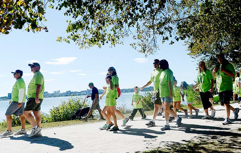 Walkers make their way around Back Cove during the Juvenile Diabetes Research Foundation International's walk to cure diabetes at Payson Park in Portland on Sunday.