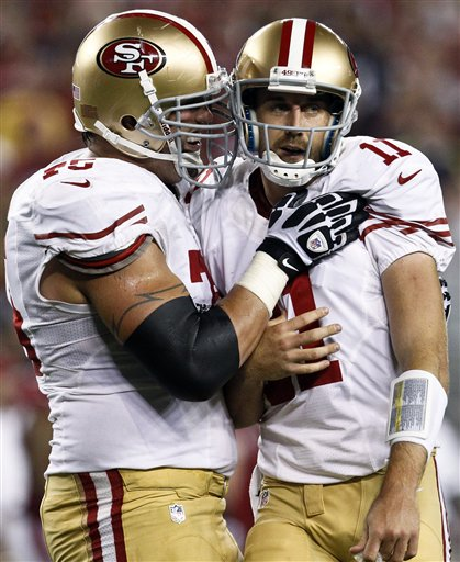 San Francisco 49ers' Alex Smith (11) celebrates his second touchdown pass of the game against the Arizona Cardinals with Alex Boone, left, during the first half of an NFL football game, Monday, Oct. 29, 2012, in Glendale, Ariz. (AP Photo/Ross D. Franklin) NFLACTION12; University of Phoenix Stadium