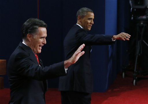 Republican presidential nominee Mitt Romney and President Barack Obama wave during the first presidential debate at the University of Denver on Wednesday.