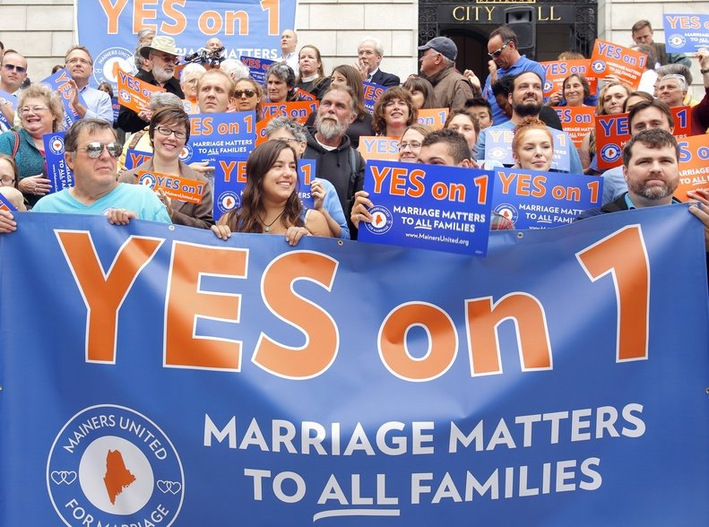 Supporters hold a banner on the steps of Portland City Hall during a rally in September supporting the same-sex marriage referendum in Maine.