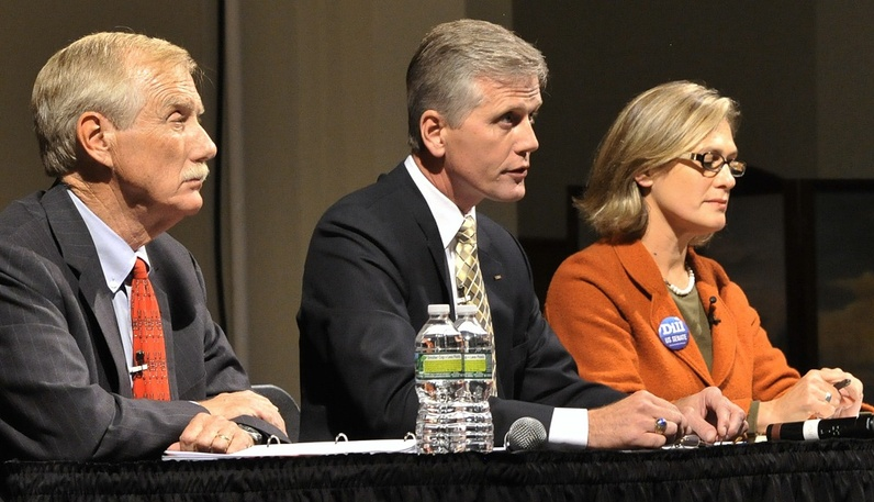 From left, U.S. Senate candidates Angus King, Charlie Summers and Cynthia Dill listen to a question at the Sept. 17 debate. Summers will skip two debates today due to scheduling conflicts, according to his campaign.