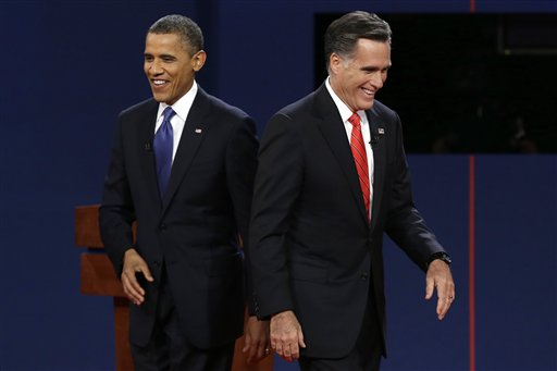 President Barack Obama walks past Republican presidential nominee Mitt Romney during the first presidential debate at the University of Denver, Wednesday, Oct. 3, 2012, in Denver. (AP Photo/Charlie Neibergall)