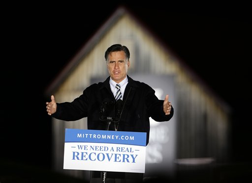 FILE - In this Oct. 17, 2012, file photo, Republican presidential candidate, former Massachusetts Gov. Mitt Romney speaks during a campaign event in front of a barn at Ida Lee Park in Leesburg, Va. President Barack Obama and Romney are engaged in an all-out effort to court women in the campaign�s closing weeks, knowing that women could help determine the winner in a series of toss-up states. Women have emerged as the pivotal voting bloc in the aftermath of the second presidential debate, where Obama and Romney sparred over contraceptives and pay inequality. (AP Photo/Alex Brandon, File)