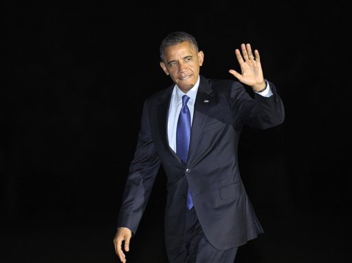 President Barack Obama waves as he returns to the White House in Washington, Wednesday, Oct. 17, 2012, after campaigning in Iowa and Ohio. (AP Photo/Susan Walsh)
