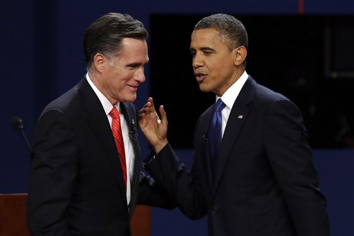 FILE - In this Oct. 3, 2012 file photo, Republican presidential candidate, former Massachusetts Gov. Mitt Romney and President Barack Obama talk after the first presidential debate in Denver. There they go again. Or do they? When President Barack Obama and Mitt Romney debate Tuesday night, the fact-checking media will be watching for the erroneous claims that have popped up repeatedly in the campaign, as well as brand new ones. Here's how you can play fact-check Whac-A-Mole, too. (AP Photo/Charlie Neibergall, File)