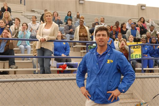 "FILE - This 2006 photo, provided by NBC Universal, shows actors Connie Britton, standing center left, as Tami Taylor, Kyle Chandler, foreground, as Eric Taylor in the NBC series ""Friday Night Lights."" Mitt Romney is giving a campaign-trail twist to an inspirational slogan from the TV series ""Friday Night Lights"" as he rides an upswing in polls after last week�s debate. The coach of the football team at fictional West Dillon High School in rural Texas would build up the Panthers by saying, ""Clear eyes, full hearts, can't lose!"" �Friday Night Lights� aired on NBC and DirectTV over five years, ending last year, and remains a Romney favorite. (AP Photo/NBC, Bill Records)"