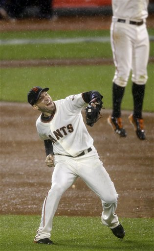 San Francisco Giants' Marco Scutaro reacts after the final out in Game 7 of baseball's National League championship series against the St. Louis Cardinals Monday, Oct. 22, 2012, in San Francisco. The Giants won 9-0 to win the series. (AP Photo/Mark Humphrey)