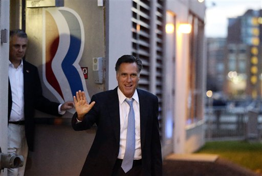 Republican presidential candidate Gov. Mitt Romney leaves his campaign headquarters in Boston on Sunday.