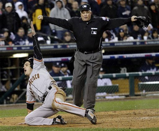 San Francisco Giants' Ryan Theriot reacts after scoring from second on a hit by Marco Scutaro during the 10th inning of Game 4 of baseball's World Series against the Detroit Tigers Sunday, Oct. 28, 2012, in Detroit. (AP Photo/David J. Phillip) MLB