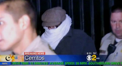 In this Sept. 15, 2012, image from video provided by CBS2-KCAL9, Nakoula Basseley Nakoula, the man behind the anti-Islamic video that inflamed parts of the Middle East, is escorted by Los Angeles County sheriff's deputies from his home in Cerritos, Calif.