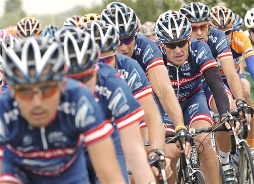 Then-U.S. Postal Service team leader and five-time Tour de France winner Lance Armstrong, third from right, rides in the second stage of the 91st Tour de France in this July 5, 2004, photo.