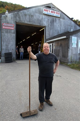 David Viger poses in front of his shop, Dave's Auto Tech in Berlin, N.H., last week. While polls show Obama's lead widening, Berlin resident David Viger says he's still eager to vote for Mitt Romney.