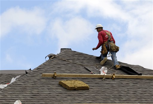In this Oct. 12, 2012, photo, a construction worker finishes a roof in Chicago. Confidence among U.S. homebuilders is at its highest level in six years in October, reflecting improved optimism over the strengthening housing market this year and a pickup in visits by prospective buyers to builders' communities.