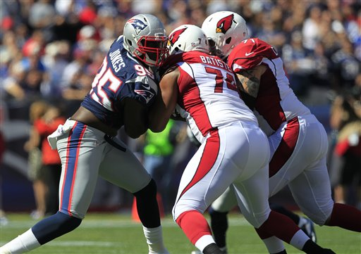 New England Patriots defensive end Chandler Jones, left, tries to get past the blocking by Arizona Cardinals tackle D'Anthony Batiste (74) and guard Daryn Colledge (71) in the first quarter of an NFL football game Sunday, Sept. 16, 2012 in Foxborough, Mass. (AP Photo/Steven Senne)