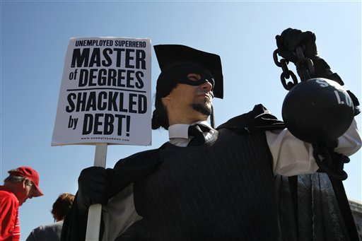 """Gan Golan, of Los Angeles, dressed as the """"Master of Degrees,"""" holds a ball and chain representing his college loan debt, recently at a protest in Washington, D.C."""