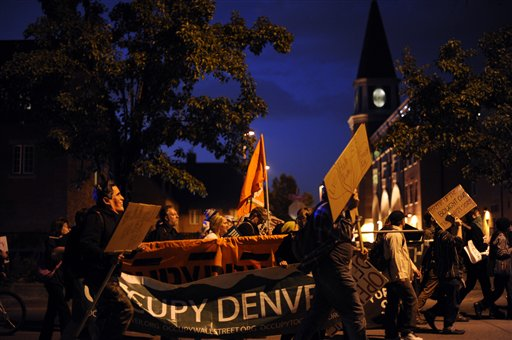 Occupy Denver protesters rally against the presidential debate around the University of Denver campus on Wednesday. About 150 protesters shouted slogans denouncing a two-party system and the war in Afghanistan and demanding affordable health care.