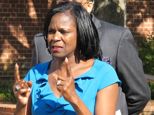 Using sign language, Angela McCaskill, chief diversity officer at Gallaudet University, addresses an Oct. 16 news conference about being placed on leave after signing a petition to put Maryland's same-sex marriage law on the ballot for voters to decide. She is asking to be reinstated to her position at Gallaudet, a university in Washington, D.C., for the deaf and hard of hearing.