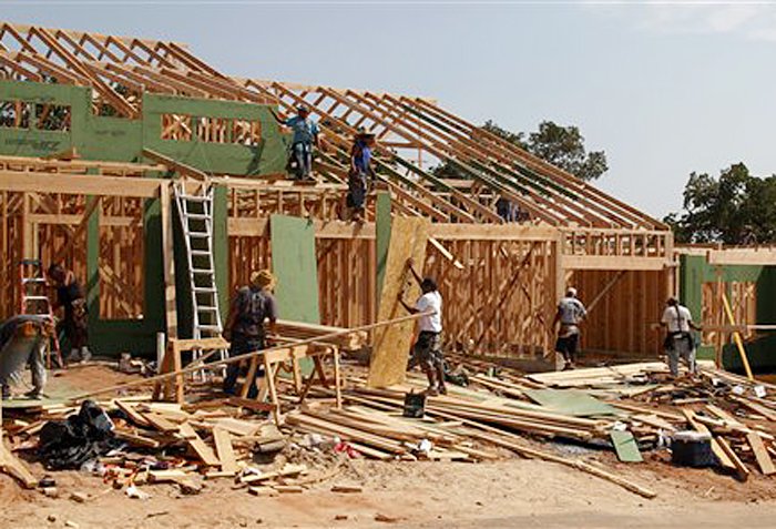 New homes are under construction in Edmond, Okla., recently. U.S. builders started construction on single-family homes and apartments in September at the fastest rate since July 2008.