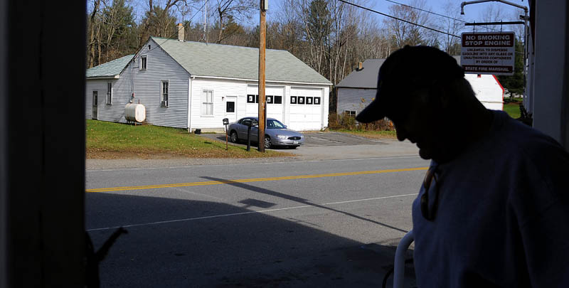 LeeAnn and Archie Miller, owners of Fayette Country Store, submitted the successful proposal to purchase the town-owned former fire station across the street. A man exits the store on Tuesday.