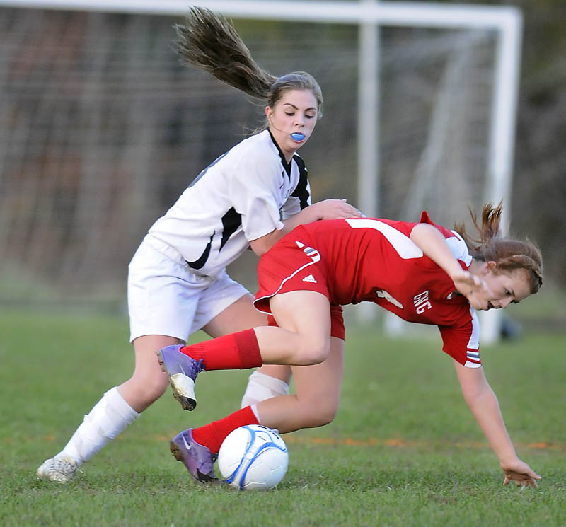 TOUGH DEFENSE: Maranacook Community School's Sarah Clough, left, knocks Gray-New Glouces-ter's Sarah Giggey away from the ball Tuesday during a Western Class B quarterfinal game in Readfield.